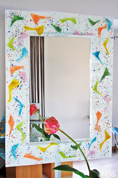 Modern mirror in white color with colored tiles