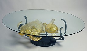 Table with gold turtles